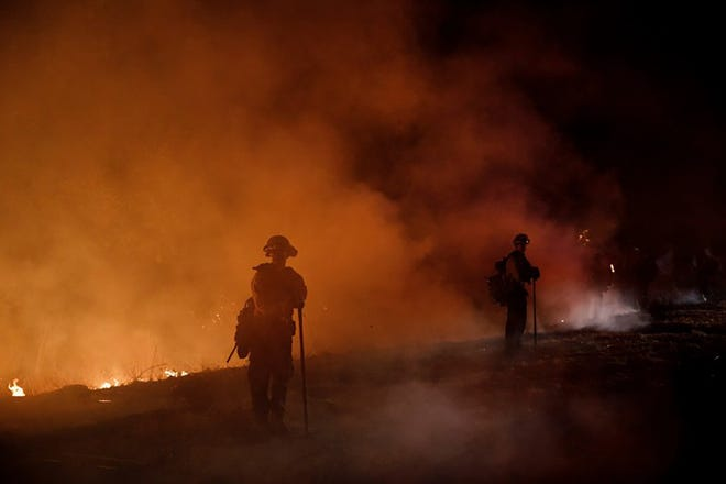 SANTA ROSA, CA - OCTOBER 28: Firefighters stand watch by a fire line along Mayacama Club Drive as the Kincade Fire burns in the outskirts of Santa Rosa, Calif., on Oct. 28, 2019. (Dai Sugano/Bay Area News Group)