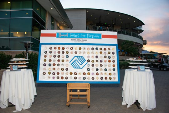 """One of the most anticipated offerings of the evening is the donut wall called """"Donut Forget Our Purpose."""""""
