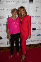 Honoree Dolores Robinson walks the red carpet with her daughter, Holly Robinson Peete.