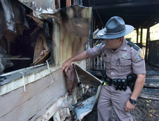 Florida Highway Patrol trooper Angel Luna rescued a 19-year-old from a burning home on Blue Angel Parkway on Sunday. Luna broke a bedroom window to free the young man.