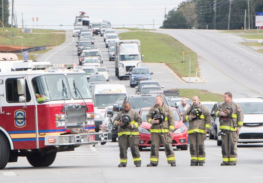 Firefighters honor one of their own at the procession for Escambia County Fire Rescue Volunteer District Chief Dwain Bradshaw.