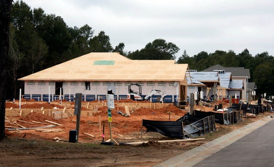 Construction continues in November at the new Cambria subdivision in Milton. Santa Rosa County is rewriting its land development code, which dictates all aspects of what a person in the county can and can't do with their land.