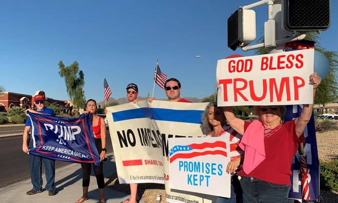A group of people chanted in support of President Donald Trump outside of a Donald Trump Jr. book signing event at a Costco in Scottsdale on Nov. 11, 2019.