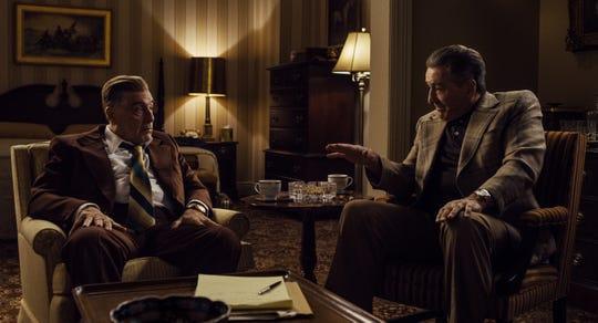 "Jimmy Hoffa (Al Pacino, left) and Frank Sheeran (Robert De Niro) debate Hoffa's next move in ""The Irishman."""