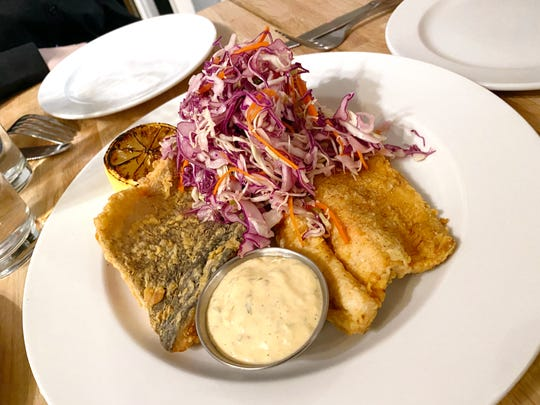 Chicken fried rainbow trout with cabbage slaw, caper Sriracha remoulade and charred lemon at New Wave in Scottsdale.