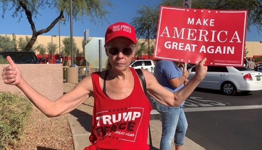 Katie McKay, of Cave Creek, chanted in support of President Donald Trump on Nov. 11, 2019, outside of a Donald Trump Jr. book signing event at a Costco in Scottsdale.