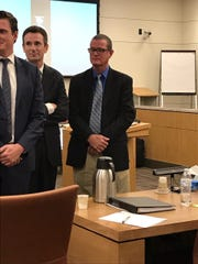Biological Resource Center owner Stephen Gore (right), with his lawyer, Timothy O'Connor.