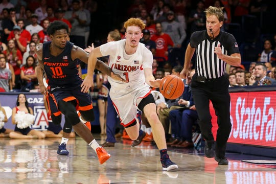 Arizona Wildcats guard Nico Mannion (1) tries to dribble past Illinois Fighting Illini guard Andres Feliz (10) during a NCAA Basketball game between the Illinois Fighting Illini and the Arizona Wildcats at McKale Center.