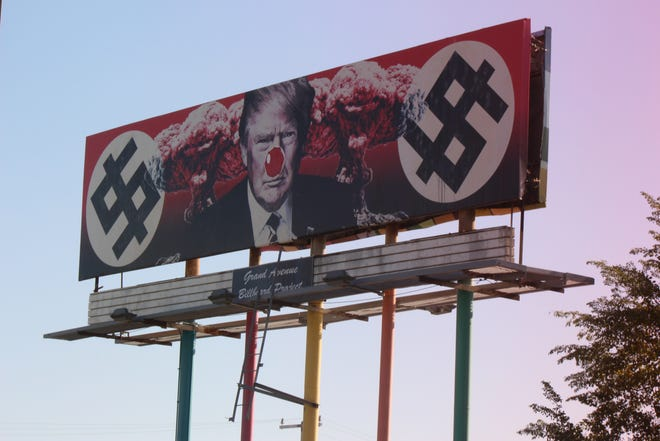 A red clown nose has been spotted on a controversial billboard featuring President Donald Trump on Nov. 12, 2019.