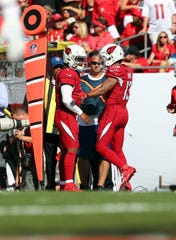 Arizona Cardinals wide receiver Christian Kirk (13) is congratulated by quarterback Kyler Murray (1) as he scores a touchdown during the second quarter against the Tampa Bay Buccaneers at Raymond James Stadium.
