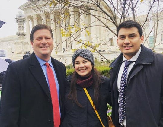 Rep. Greg Stanton (D), Reyna Montoya and Mario Montoya stand in front of the Supreme Court ahead of DACA hearings on Nov. 12, 2019.