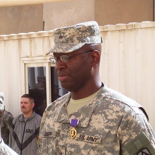 Staff Sergeant Louis Joseph receiving the Purple Heart Award