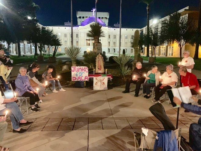 A prayer vigil was held Monday night at the Arizona State Capitol on the eve of the U.S.Supreme Court hearing that could decide whether residents brought to the U.S. as children will be able to stay in the country.