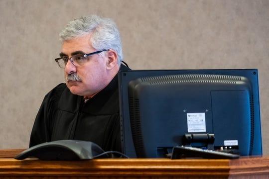 St. Clair County Probate Judge John Tomlinson presides over Mental Health Court Tuesday, Nov. 12, 2019, in his courtroom in the St. Clair County Courthouse in Port Huron. The program is in its eleventh year.