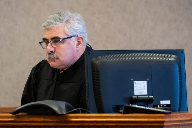 St. Clair County Probate Judge Tom Tomlinson presides over Mental Health Court Tuesday, Nov. 12, 2019, in his courtroom in the St. Clair County Courthouse in Port Huron. The court requested more than $404,000 in funding for fiscal year 2021 to accommodate an increase in participation and the addition of a designated defense attorney.