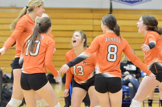 Armada's Emma Stark celebrates with her teammates against North Branch during the Division 2 volleyball regional semifinal on Tuesday, Nov. 12, 2019, at Ortonville Brandon.