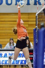 Armada's Anika Prisby goes for a kill against North Branch during the Division 2 volleyball regional semifinal on Tuesday, Nov. 12, 2019, at Ortonville Brandon.