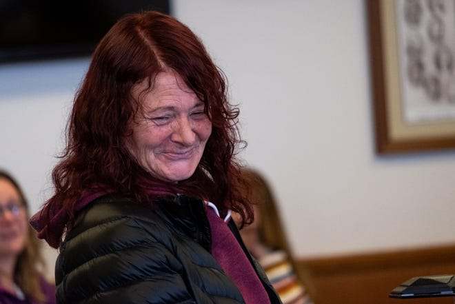 Melissa Olsen smiles while standing at the podium in St. Clair County Mental Health Court Tuesday, Nov. 12, 2019, in the St. Clair County Courthouse.