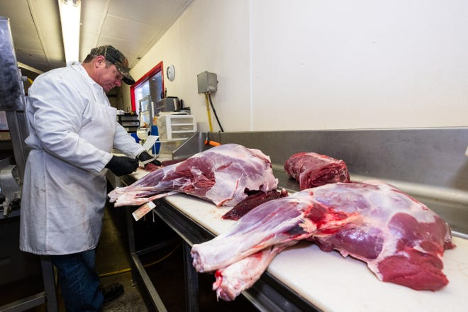 Joseph Ilowski, owner of Ilowski Sausage Co. in East China, works to cut deer meat Tuesday, Nov. 12, 2019, in his shop.