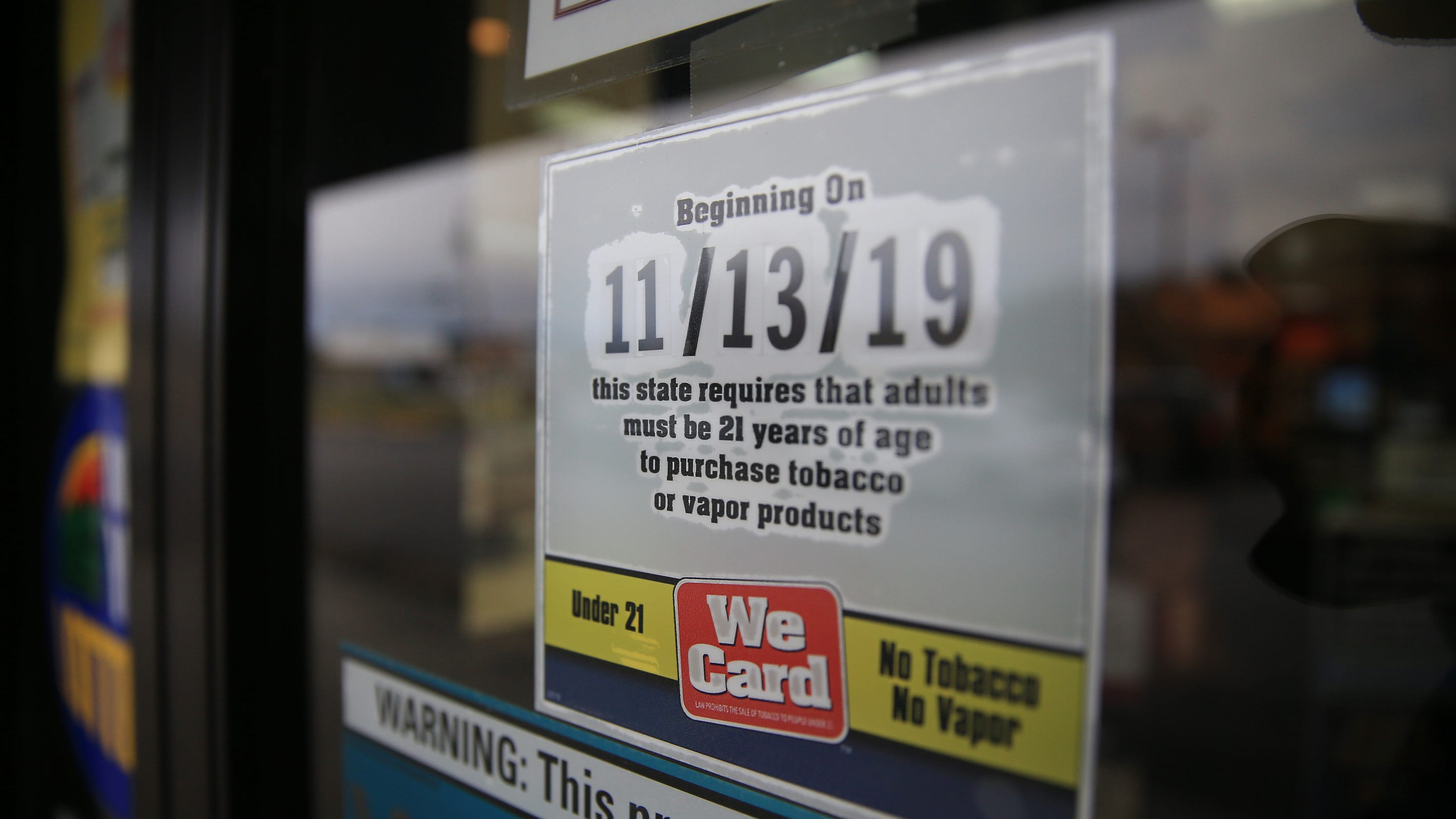 Shop owners react to raised smoking age across NYS