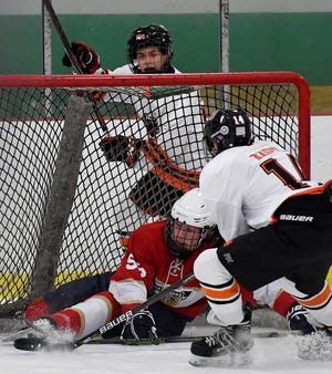 Central York's Benjamin Kasper follows the puck and shoots for a goal against West Shore goalie Mike Daily on Monday, Nov. 11, 2019, in a Central Penn Interscholastic Hockey League contest. The 2020-2021 CPIHL season has been canceled because of the COVID-19 pandemic. John A. Pavoncello photo