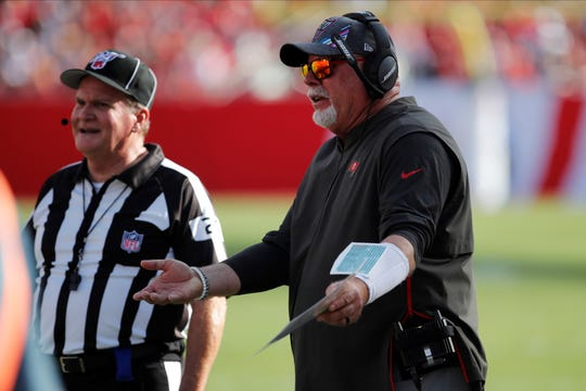 Tampa Bay Buccaneers head coach Bruce Arians talks to side judge Jeff Lamberth (21) during the second half of an NFL football game against the Arizona Cardinals Sunday, Nov. 10, 2019, in Tampa, Fla. (AP Photo/Mark LoMoglio)