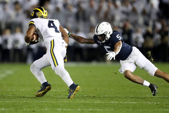 Oct 19, 2019; University Park, PA, USA; Penn State Nittany Lions cornerback Tariq Castro-Fields (5) pursues Michigan Wolverines wide receiver Nico Collins (4) during the second quarter at Beaver Stadium. Mandatory Credit: Matthew O'Haren-USA TODAY Sports
