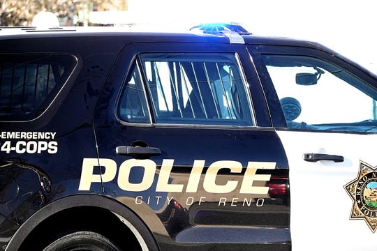 A closeup photo of the Reno Police Department's logo on the side of a patrol vehicle.