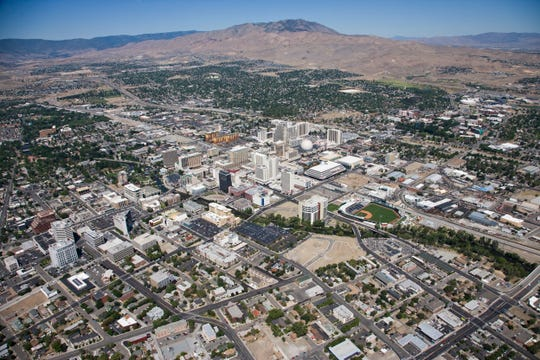 Aerial view of downtown Reno, including the Truckee River and UNR.