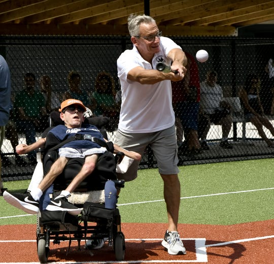 "Challenger Miracle Field has a rubberized, barrier-free playing surface so adults and children with physical or mental challenges can have a safe, accessible facility to play a variety of sports like baseball, soccer, and flag football. ""The hugs, the kisses, the friendships, it's just so rewarding,'' said co-founder Ron Kampff, shown hitting. Kampff is using the inspiration he derives from ""his kids'' in his recovery from serious injuries suffered in a bike accident Oct. 20."