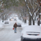 Un-plowed sidewalks makes some walk in the streets in Rochester.