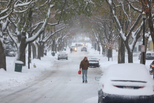 Snow covered sidewalks in some areas, like Curlew St. in Rochester, has forced pedestrians to walk in the street.