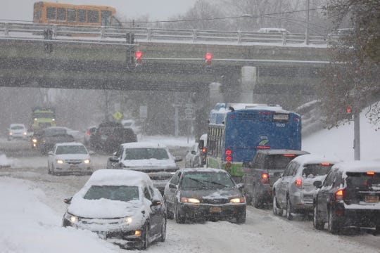 FILE PHOTO: Cars heading north on Carter Street during a snowstorm.