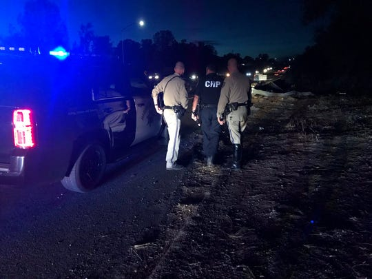 California Highway Patrol officers on Monday, Nov. 11, 2019 investigate a high-speed crash on Highway 44 between Victor Avenue and Shasta View Drive exits.