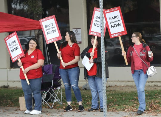 Nurses, caregivers and other health care workers hold a union-backed informational picket outside Shasta Regional Medical Center on Tuesday, Nov. 12, 2019. The employees are encouraging hospital administrators to increase staffing levels for the winter months and beyond.