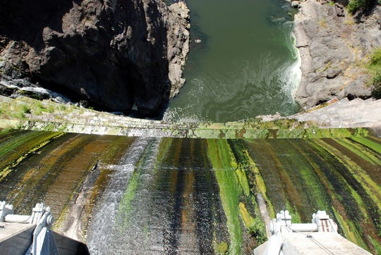 Water trickles over Copco 1 Dam on the Klamath River outside Hornbrook, Calif.