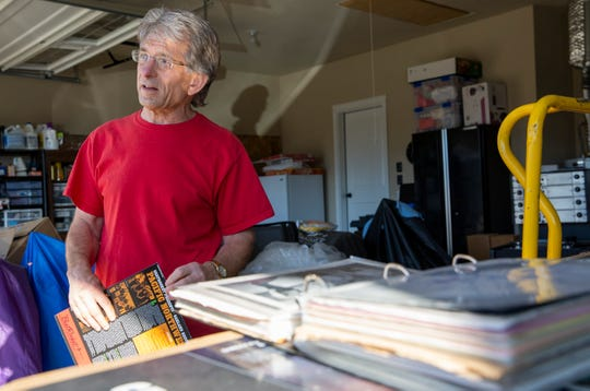 Chuck Stenberg shows a portfolio of archived Garland Records material at his home in Sublimity on Nov. 1. Chuck Stenberg acquired original studio master tapes from Garland Records and has since been invested in maintaining its legend.