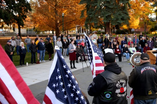 The Old Guard Riders display American flags during a Veterans Day celebration hosted by the Oregon Department of Veterans' Affairs at the Oregon WWII Memorial in downtown Salem on Nov. 11, 2019.