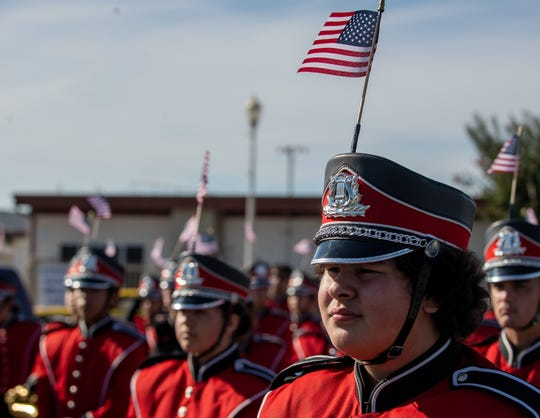Members of the North Salinas High School band await the start of the 2019 Veterans Day Parade on Monday, Nov. 11, 2019.
