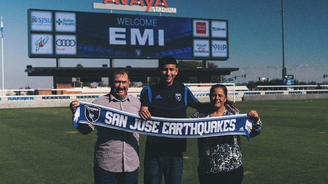 Salinas native Emmanuel 'Emi' Ochoa poses with his parents on a visit to Avaya Stadium, home to the San Jose Earthquakes.