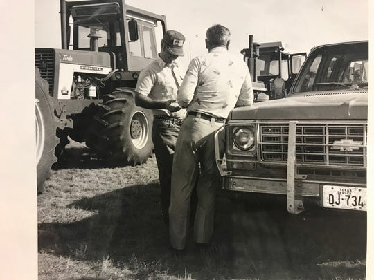 San Angelo area farmers discuss strategy before heading off in a tractorcade to protest poor market conditions in December of 1977.