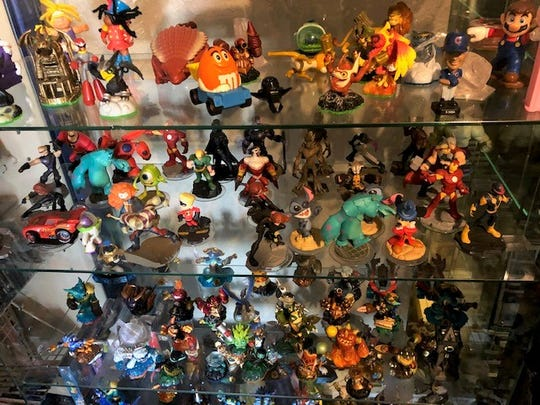 Collectible action figures on display at Retro Game Press.