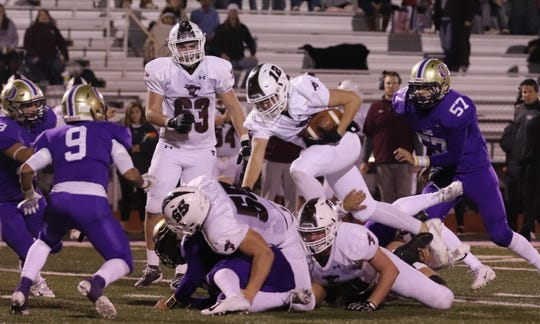 Hawley High School's Austin Compton climbs over the pile of linemen for a few yards against Ozona in a District 3-2A Division I game Friday, Nov. 8, 2019, in Ozona.