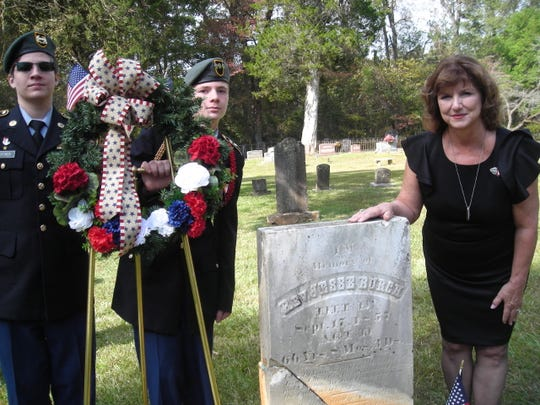 Cadet M. Sgt. Jacob Hoffney  and Cadet Capt. Jack West with Cindy Madden, at the grave of the Rev. Jesse Burch, one of two War of 1812 veterans honored by Daughters of War of 1812. The Daughters marked both graves with medallions and Madden created the wreaths for the ceremony.
