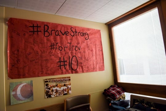 A poster signed by Britton students hangs in Trevor Zuehlke's hospital room on Tuesday, Nov. 12, 2019 at Avera Health. Zuehlke, a Britton-Hecla High School quarterback, suffered a traumatic brain injury that left him in a medically induced coma.