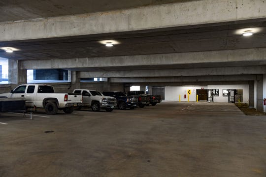 Journey Construction vehicles are parked in the lower level of the in-progress downtown parking ramp on Tuesday, Nov. 12, in Sioux Falls.