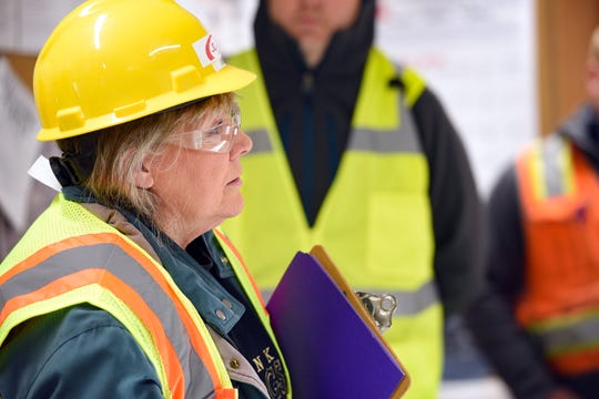 Sioux Falls City Councilor Theresa Stehly asks senior project manager Tony Wiseman to explain what the estimated $1.5 million will be used for during a tour of the in-progress downtown parking ramp on Tuesday, Nov. 12, in Sioux Falls.