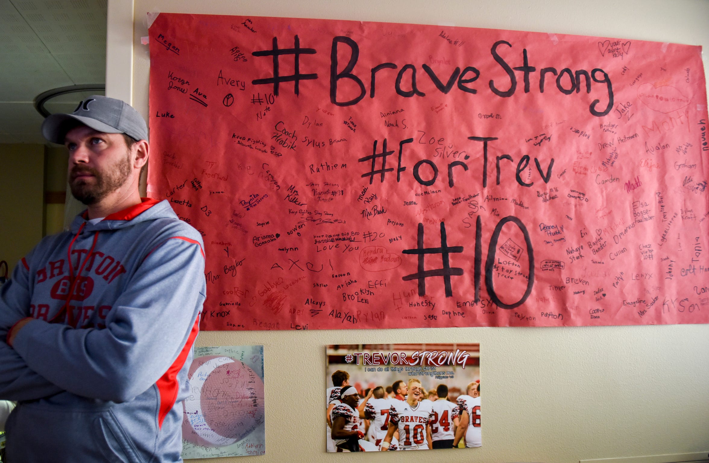 Kurt Zuehlke, dad of Trevor Zuehlke, stands next to a poster signed by Britton students on Tuesday, Nov. 12, 2019 at Avera Health.