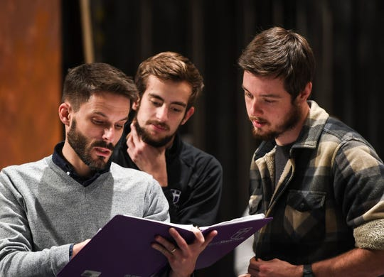 """Director Joe Obermueller, Will Grisham as """"Narrator"""" and Drew Veurink as """"Jesus"""" look over the script from a scene in Heaven to Heaven on Thursday, Nov. 7, 2019 at University of Sioux Falls. The musical about the life of Jesus premieres at 7 p.m. on Nov. 20, 2019, in the Jeschke Fine Arts Center at USF."""