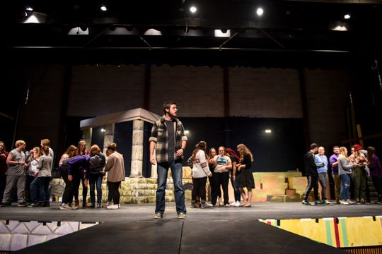 """Drew Veurink in the role of """"Jesus"""" rehearses a scene with other cast members from Heaven to Heaven on Thursday, Nov. 7, 2019 at University of Sioux Falls. The musical about the life of Jesus premieres at 7 p.m. on Nov. 20, 2019, in the Jeschke Fine Arts Center at USF."""